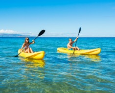 Couple Kayaking in the Ocean on Vacation-resized