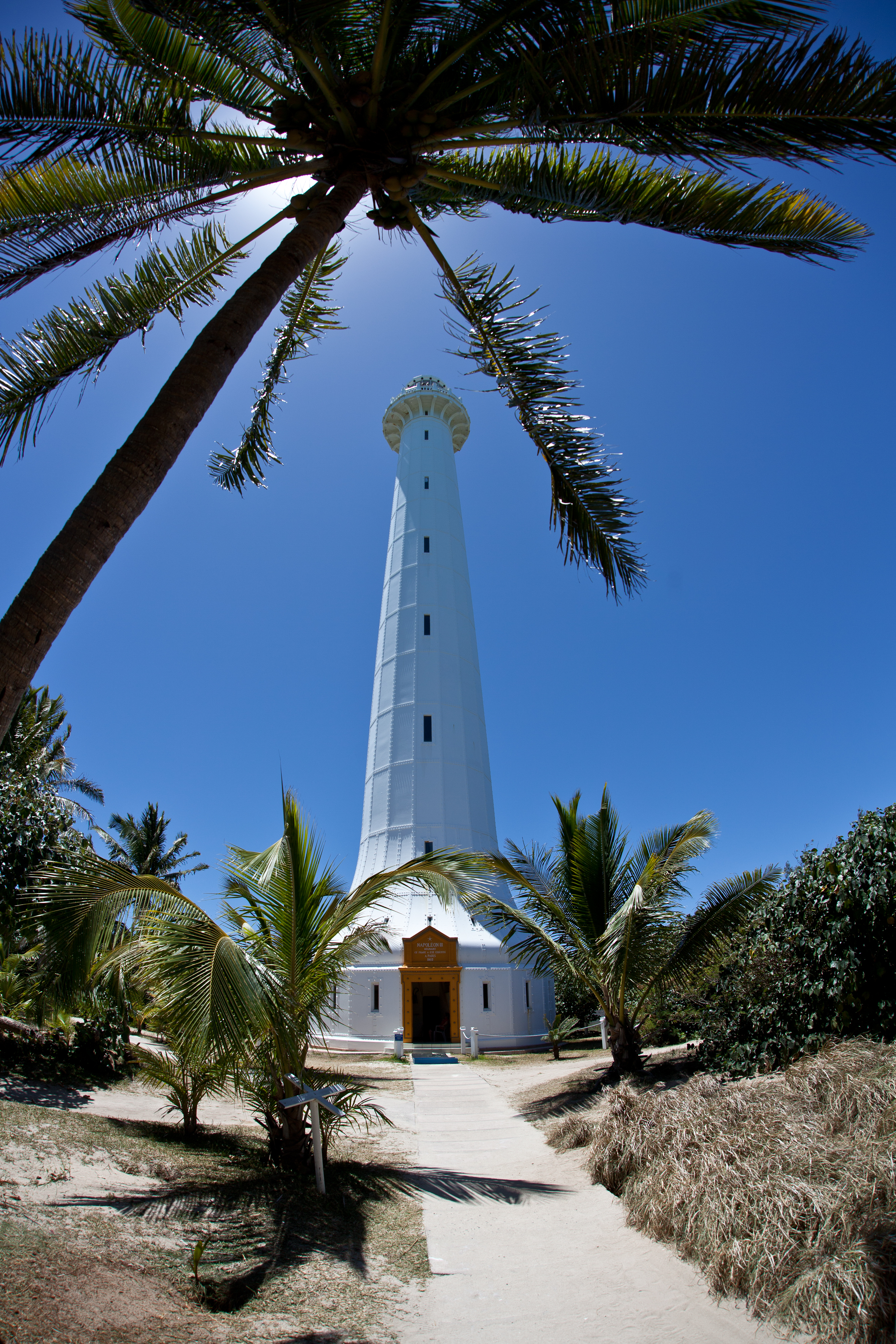 A tall lighthouse is built on Amadee Island just off New Caledonia. Visitors can climb to the top and get a beautiful view of the surro