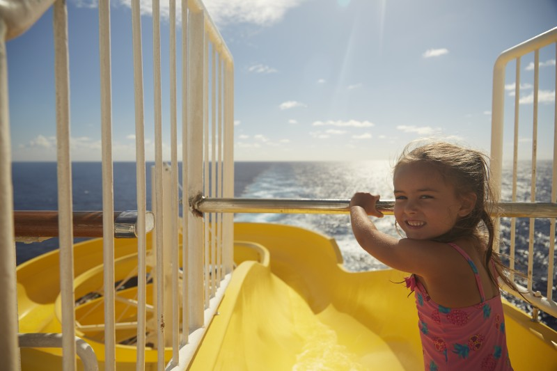 yellow waterslide child